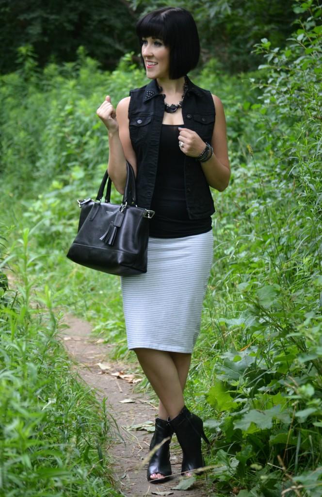 edger look, killer heels, open-toed booties, black shoes, denim vest, black vest, statment necklace, coach purse, tank top