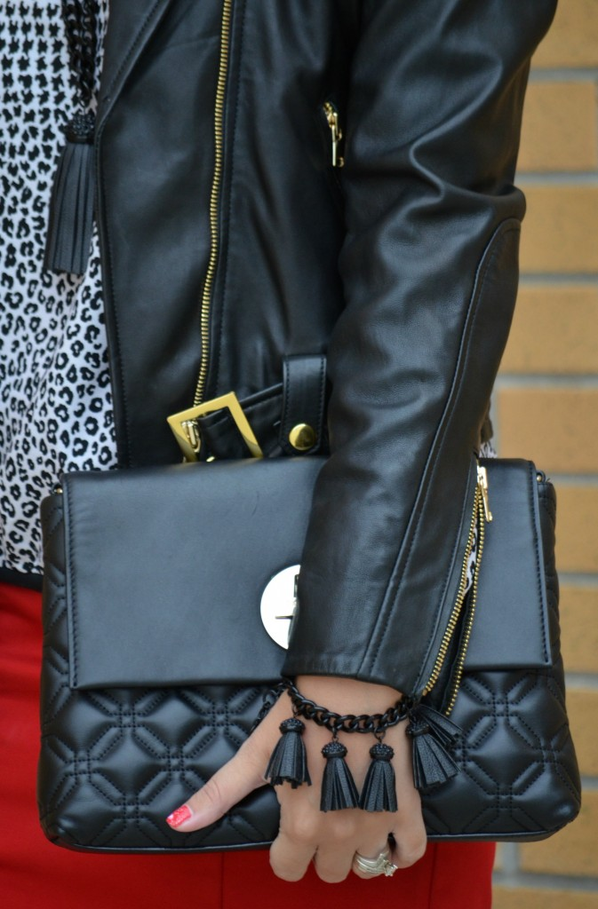 Red skirt, kate spade handbag, black purse, statement necklace, gold pumps, gold shoes, sparkly heels, guess shoes