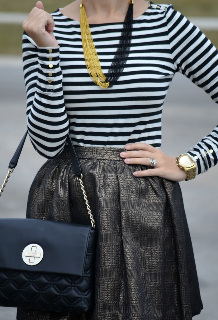 black and white striped Top,  H&M blouse, gold Necklace, Pearls for Girls jewelry, oversized gold Watch,  Guess gold watch, black handbag, Kate Spade purse, metallic gold Skirt