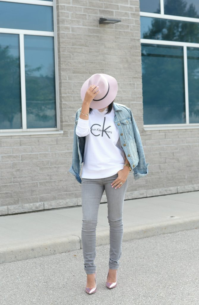 White Calvin Klein Sweater, CK Sweater, Who to wear a Logo Sweater, Toms Sunglasses, Pink Fedoa, Wittnauer Watch, Gold Watch, Denim Jacket, Gap Denim Jacket, How to style a jean jacket, how to style a denim jacket, jean jacket